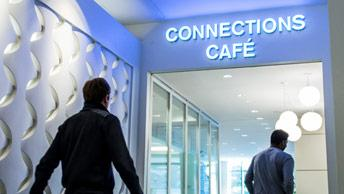 Employees walk in to the employee cafe at Verisign